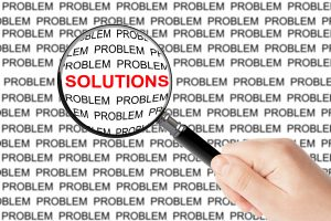 "A magnifying glass over the word ""solutions"""
